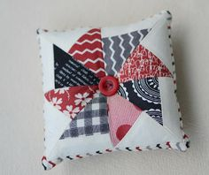 I bet I could do a similar pattern as a throw pillow using old ties to create the star (pinwheel).....hmmmm.