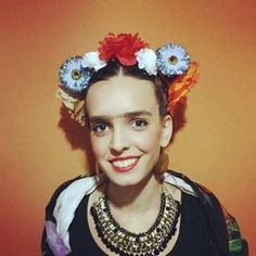 Channel Frida with fake dollar-store flowers and an eyebrow pencil. | 51 Cheap And Easy Last-Minute Halloween Costumes