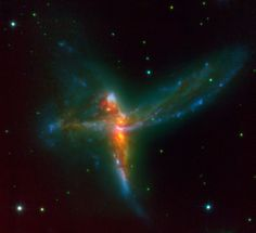 Using ESO's Very Large Telescope, an international team of astronomers [1] has discovered a stunning rare case of a triple merger of galaxies. This system, which astronomers have dubbed 'The Bird' - albeit it also bears resemblance with a cosmic Tinker Bell - is composed of two massive spiral galaxies and a third irregular galaxy.