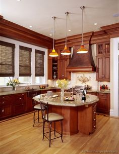 Cherry cabinets, light wood floor with light countertops.