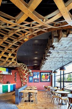 Latticework in plywood rises from reclaimed parquet inside Loughton, U. restaurant Nando's, a combo symbolizing the fusion of Portuguese-African cuisine. Photography courtesy of Hufton + Crow. Retail Interior, Restaurant Interior Design, Commercial Interior Design, Commercial Interiors, Fast Casual Restaurant, Casual Restaurants, Restaurant Bar, Interior Design Magazine, Interior Design Inspiration