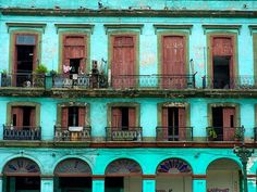 weathered teal paint ... repetition of the doors and balconies