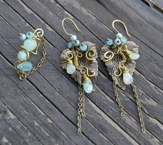 Light blue set in brass  Check out this item in my Etsy shop https://www.etsy.com/listing/222808491/light-blue-earrings-wire-wrapped