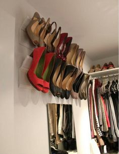 shoe storage rails made from crown molding and baseboard