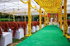Love the marigold canopy over the ceremony aisle for an outdoor wedding!  Beautiful and functional! #southasian #indian #weddingideas #weddingdecor #weddingstyling