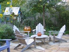 This is exactly what I want! A stone patio like this, and four adirondack chairs... except around our fire pit.