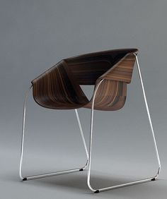 The bookmatching of the veneer on the back of the chair is worth seeing too. Furniture by Velichko Velikov, via Behance