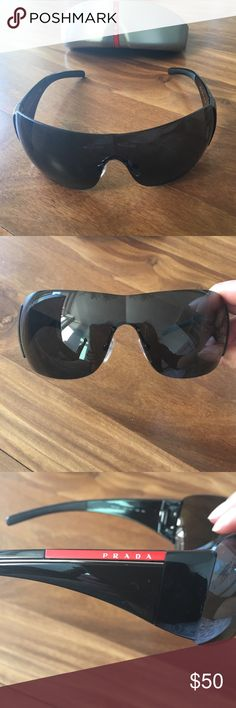 Oversized Prada Sport sunglasses Glamorous oversized wrap around style sunnies. In good condition though there is a small scratch at top right part of lense. Comes with hard glasses case. Gucci Accessories Sunglasses
