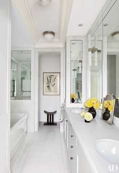 Nina Garcia luxurious bathroom, all in white, with both classic and modern nordic details.