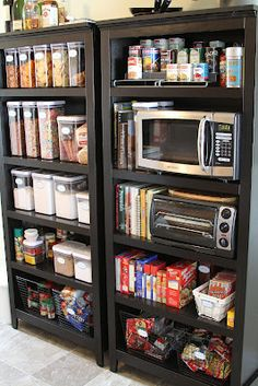 of the Best Home Organizing Ideas for Anyone's Budget Tiny kitchen? No problem. Use a bookshelf as a standalone pantry. No problem. Use a bookshelf as a standalone pantry. Bookshelf Pantry, Kitchen Pantry Storage, Bookshelves, Pantry Diy, Bookcase, Open Pantry, Tiny Pantry, Tiny House Storage, Small Storage