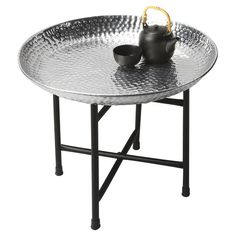 End table with a removable aluminum tray top and black iron base.  Product: End tableConstruction Material: Iron...