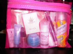 Pink Mesh Makeup Bag With Asstd. Beauty Products Inside.