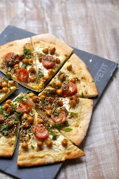 Whole wheat Pizza with Lebneh cheese, cumin scented chickpeas & Middle Eastern spice mix.