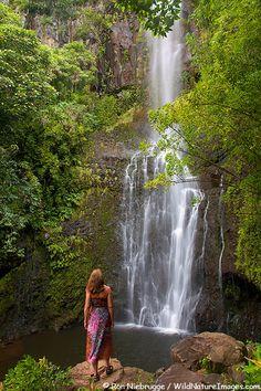 A visitor a Wailua Falls along the Hana Highway, Maui, Hawaii