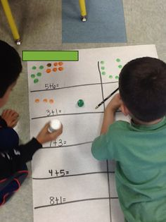 Making addition sentences using do-a-dots and large paper. This is in a first grade classroom, but could work in any lower elementary class.