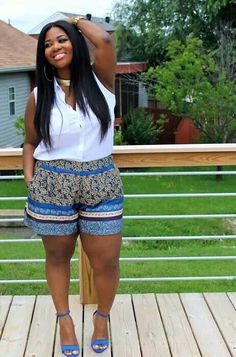 Printed shorts and plain white sleeveless shirt