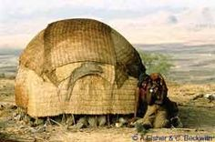 Africa | Nomad Dome-shaped House of Afr Tribe. Eritrea. Afar people are nomad living in Great Rift Valley.  Their house is called Bulla which is transferable compact dome shaped house.  The house is made of straw which is easy to carry. | © Carol Beckwith and Angela Fisher.