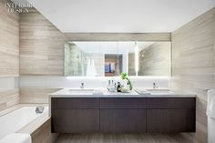 Fit to Print: Workshop/APD Makes Headlines at NYC Printing House Apartments | Limestone lines the master bathroom. #design #interiordesign #interiordesignmagazine #architecture #bathroom #limestone