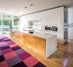 Dwell - Plum Modern Pendant Lighting Adds Pop of Color in Canadian Kitchen