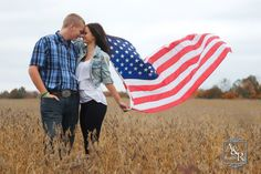High school senior couple in bean field with American flag.png  A&R Portraits Durand Michigan.  http://www.arportraits.com