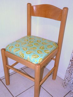 Sarah recovered a chair cushion to add a little flair to her dining room!