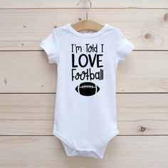 I'm Told I Love Football Onesie | Etsy Football Onesie, Making Shirts, Baby Born, Girls Tees, Tell Me, Onesies, Kid, My Love, Etsy