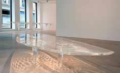 'Liquid Glacial' tables by Zaha Hadid -- Love the reflections the table creates on the floor!
