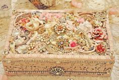 vintage jewelry and found objects decorate an old box