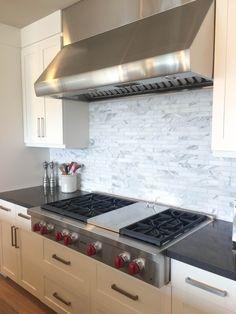 Contemporary kitchen, carrera marble backsplash, custom marble backspash, wolf cooktop, gray and white kitchen