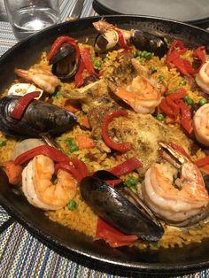 Paella of organic chicken, chorizo, gulf shrimp, calamari, saffron, cauliflower, piquillo pepper Restaurant History, Chicken Chorizo, Organic Chicken, Calamari, Paella, Tapas, Cauliflower, Shrimp, Pepper