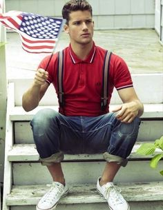 Red Polo styled with Blue Ripped Jeans,White, Red and Navy Vertical Striped Suspenders and a pair of White Sneakers