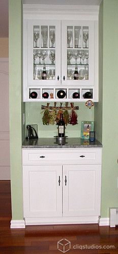 Painted White Dayton kitchen cabinets from CliqStudios with a built-in wine rack.    http://www.cliqstudios.com