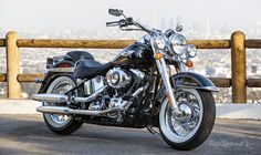 Image from http://pictures.topspeed.com/IMG/crop/201309/harley-davidson-softail-deluxe-05_600x0w.jpg.