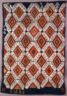 "Diagonal rows of lozenges with saw-toothed edges embroidered in red, white, buff and yellow silk on a blue ground. This pillow cover is medium: silk embroidery on linen foundation technique: embroidered in counted running stitch on plain weave foundation. Its dimensions are: H x W: 39 x 59 cm (15 3/8 x 23 1/4 in.). This pillow cover is from Greece and dated ""18th century""."