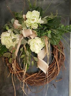 Handmade item Materials: grapevine wreath, glue, wire, wired burlap, realistic fern, realistic greenery Made to order Ships from United States Questions? Contact shop owner Item details This beautiful peony burlap front door greenery wreath is the perfect simple accent for your door or interior. A wired burlap ribbon makes a simple bow. FRONT DOOR WREATH Average Diameter: 22 (tip to tip) This wreath will be created on a grapevine wreath measuring approximately 18 Indoor/ Sheltered Outdoor...