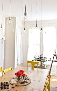 Love these simple hanging lights over the kitchen table.