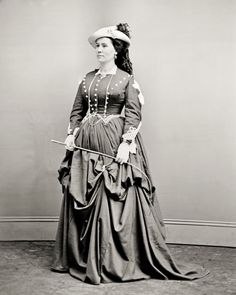8 by 10 Civil War Photo Print Lady Wearing Riding Habit   eBay. At least one skirt elevator visible, between her hands; other places, the skirt seems to be looped up/tied inside.
