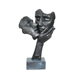 Celebrate romantic love with this sculpture depicting a kissing couple. Sporting a rich, dark finish, this unique sculpture is crafted from polyester resin for the look of real stone. Details: Figurin