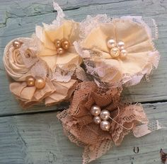 Linen and Lace Fabric Flowers - can easily do this, using layers of cotton, lace and chiffon, and then some beads. We canuse recycled fabrics too!