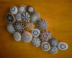 Canadian Woman doctor mother creator's crochet covered rocks on yellow oomen