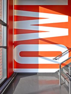 Interior detail of KNOWLEDGE IS POWER stairwell graphic.