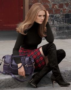 Red Tartan, Black Leather Boots and Black long-sleeve Turtleneck, with only one, thin inch of skin to show.