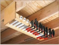 Garage Overhead Clamp Rack Short Lengths Of Pvc Pipe Held In the Garage Ceiling . Garage Overhead Clamp Rack Short Lengths Of Pvc Pipe Held In the Garage Ceiling Storage solutions Workshop Storage, Workshop Organization, Shed Storage, Garage Organization, Tool Storage, Garage Storage, Storage Rack, Organization Ideas, Storage Ideas