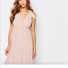 0c027515726d Shop Women s TFNC Pink size 2 Wedding at a discounted price at Poshmark.  Description  TFNC WEDDING Cold Shoulder Wrap Front Midi Dress - Peach blush    US ...