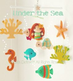 Spin & Musical Baby Mobile with Mermaid Under the Sea Theme (Artist Choice Color) -  Hanging Crib Mobile for Modern Nautical Nursery Decor. $185.00, via Etsy.
