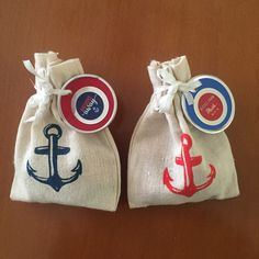 """Favors for nautical themed baby shower. Little sacs from Oriental Trading and perosonalized labels. """"Kisses from baby!"""""""
