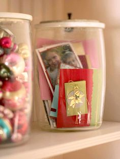 You've Got Mail : Slip just-arrived holiday cards inside glass canisters, and safeguard favorite vintage tree ornaments by tucking them inside another canister, then display the containers on an open shelf. :: cute idea!