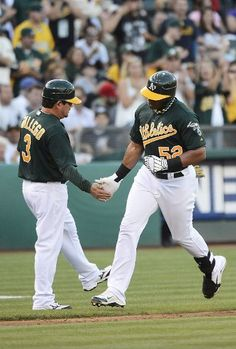 OAKLAND, CA - JULY 21: Yoenis Cespedes #52 of the Oakland Athletics is congratulated by third base coach Mike Gallego #3 after Cespedes his a solo home run in the fourth inning against the New York Yankees at O.co Coliseum on July 21, 2012 in Oakland, California. (Photo by Thearon W. Henderson/Getty Images)