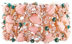 ARTEMEST - PARADISO PINK CORAL BRACELET: This 18k rose gold bracelet by the historic Neapolitan house De Simone was inspired by the idea of heaven or paradise. The bracelet is decorated with hand-carved leaves made of angel skin coral, as well as emeralds and diamonds - a combination which results in soft yet striking femininity. Material: Rose Gold 18k, Diamonds, Emeralds, Angel Skin Coral