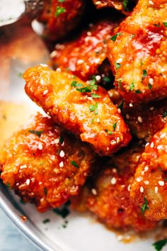 Honey Sriracha Baked Chicken Bites - these are perfectly addicting bites that are great for the BIG GAME or to serve with a side salad or fries for dinner. Crispy chicken that's BAKED and not fried! What's better? #chickennuggets #chickenwings #chickenbites #honeysriracha | Littlespicejar.com